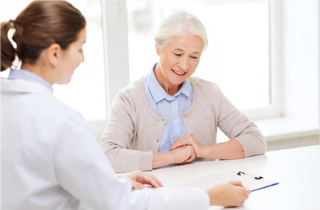 health-care professional reviewing document with participant